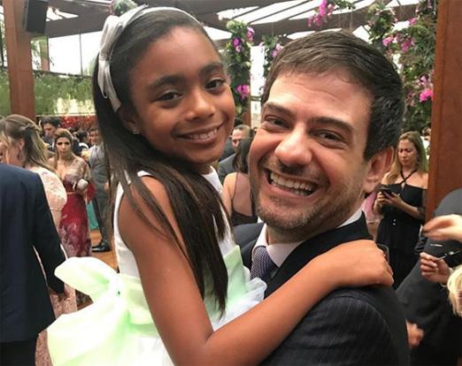 Bruno Astuto com a afilhada Laura